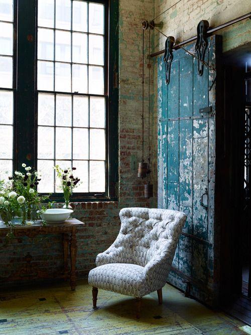 modern loft, antique chair, industrial door