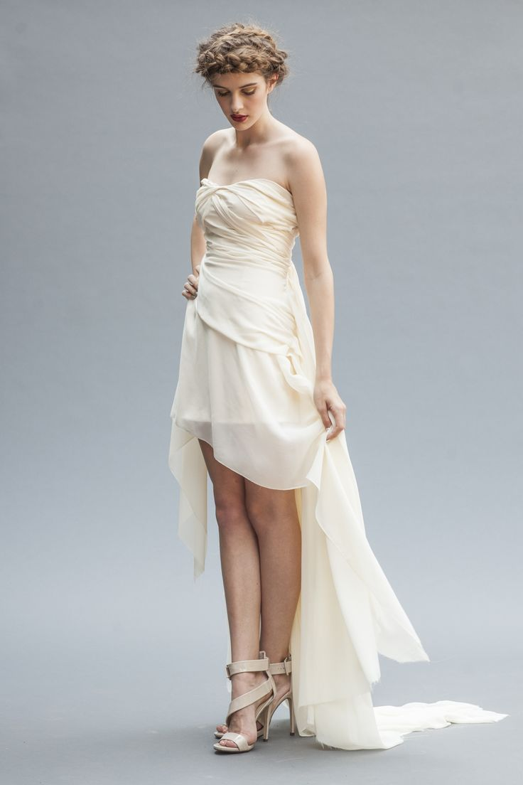The exquisite Athena, a signature Elika In Love.  Shop the look: www.elikainlove.com  This luxurious silk chiffon wedding gown was created for an elegant bride looking for a captivating gown that is fresh, modern, and romantic.