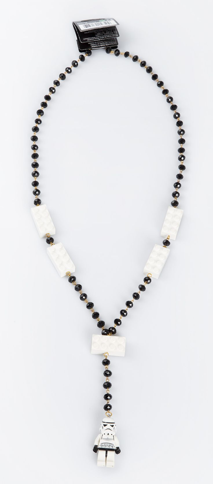 Unique necklace with combination of black and white beads, white Lego blocks and Storm Trooper Lego as a main detail in this necklace. http://www.zocko.com/z/JJylr