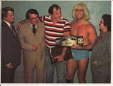 September of 1981 Ric Flair wins his first NWA Title, pictured with Jim Crockett Jr, his father Richard, former NWA Champ  Pat O'Connor and his mother Kay