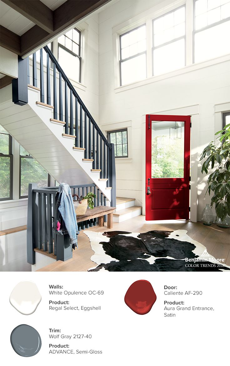 A symbolic red door painted in caliente af 290 announces an enthusiastic welcome in this classic seaside summerhouse