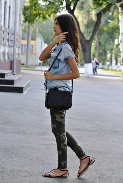 Chambray shirt, camouflage pants.