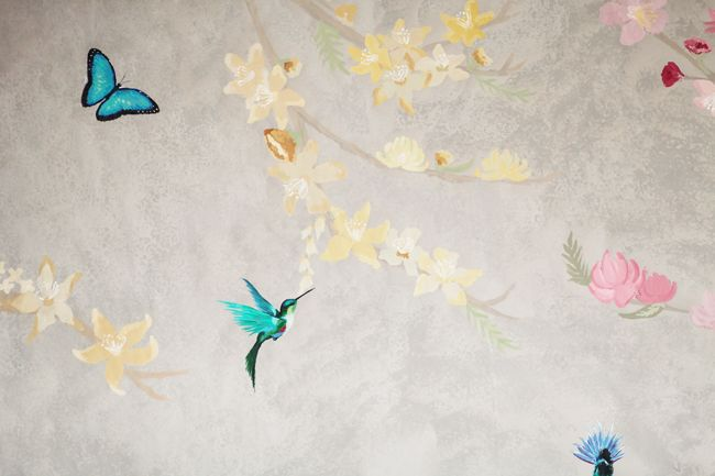 Here is a close up of the beautiful backdrop hand-painted by our creative team for our latest spring lookbook, Awakening!
