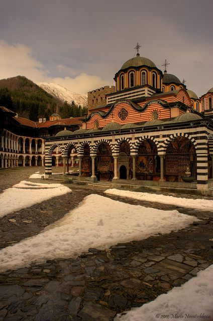 Rila Monastery, Sofia, Bulgaria. Amazing place to visit, I've been here. The inside of the chapel looks like solid gold, I think it's bronze. The monk we saw was a bit tipsy, though... A little too much communion wine perhaps ;) lol. We saw another monk in robes using a cell phone. :)