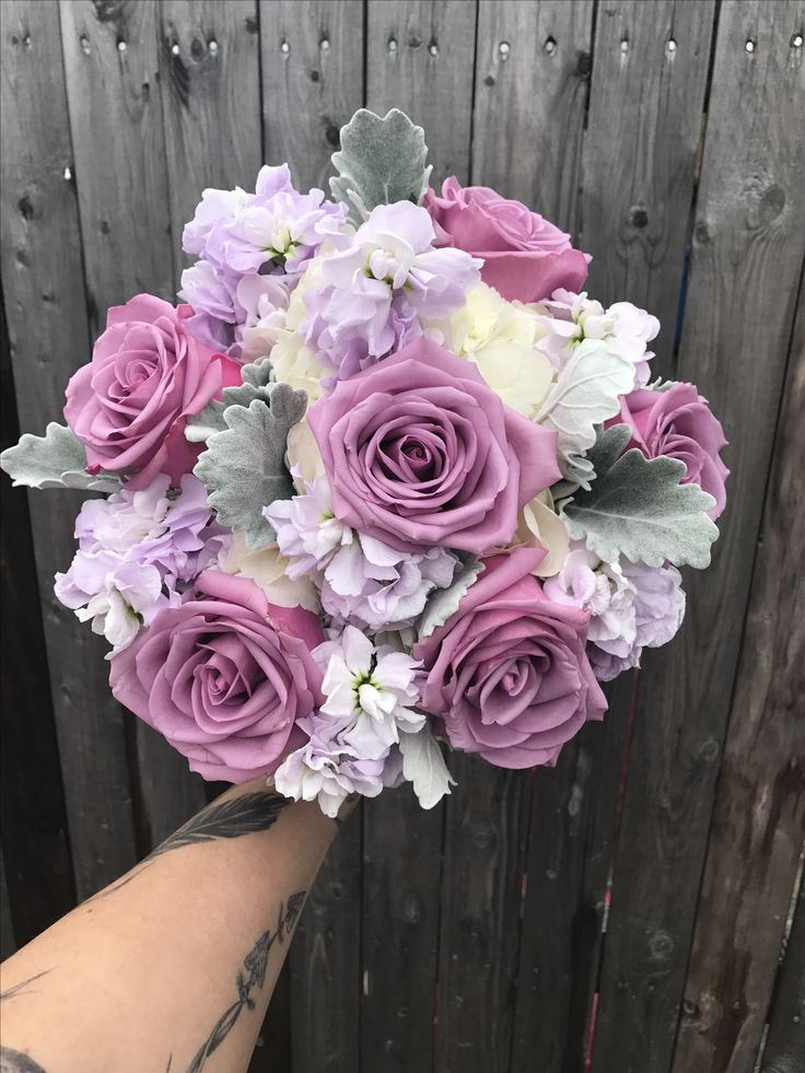 Wedding bouquet of white hydrangea, Cool Water roses, Apple Blossom stock and dusty miller.