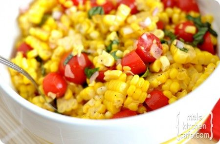 Summer Corn Salad - 6 ears of corn, shucked  1/2 cup finely diced red onion  1 cup cherry tomatoes, sliced in half  3 tablespoons cider or red wine vinegar  3 tablespoons extra-virgin olive oil  1/2 teaspoon kosher salt  1/2 teaspoon freshly ground black pepper  1/2 cup julienned fresh basil leaves