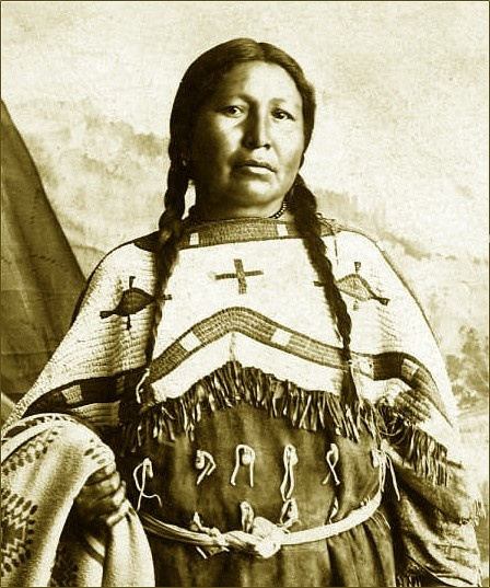 A portrait of a Sioux woman, identified as Mrs. Bluebird. Photo taken between 1880 and 1910.