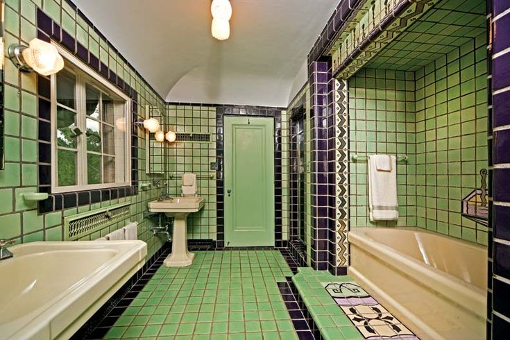 Original 1930 bathroom. Very cool, but I think all that green would be a little much for me!