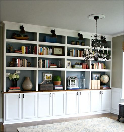Built-ins.  We'll be making something like this for our office... from scratch. I especially like the lighting at the top.