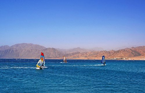 Windsurfers near Dahab, Red Sea Egypt | Where to go on holiday in May | #travel