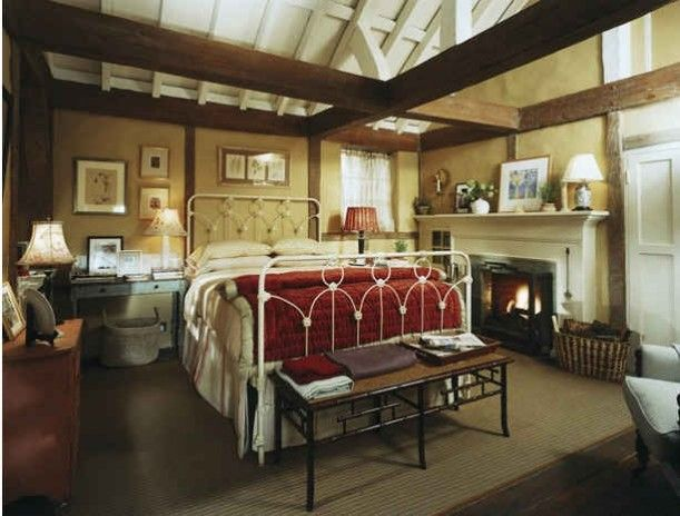 """From """"The Holiday."""" I love the idea of a fireplace in the master bedroom. This room is so rustic and cozy!"""