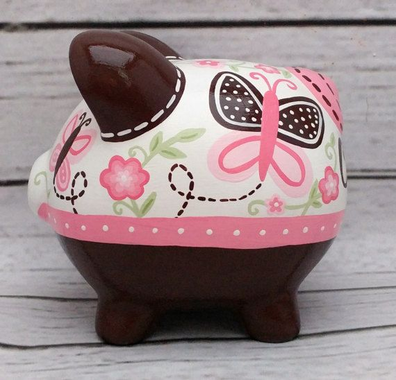 Alcancía personalizada rosa y marrón con verde mariposa
