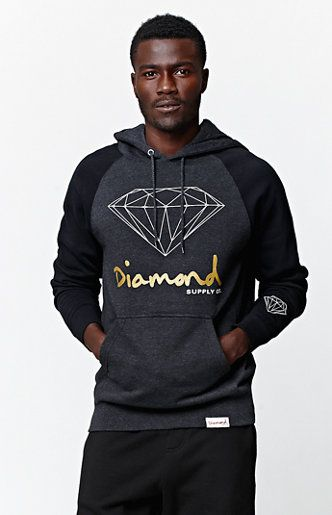 Online Only! The men's Script Raglan Hoodie by Diamond Supply Co offers gold foil lettering along with the diamond logo. This hoodie has two-toned coloring for a cool, casual look along with soft fleece fabric.   	Pullover hoodie 	Long sleeves 	Graphic 	Front pouch