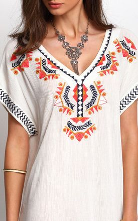 Slip into summer with this pretty embroidered dress. The beautiful embroidered detailing and colourful pattern gives it a fun boho and vintage feel. Perfect for the warm summer evenings. Shop Now