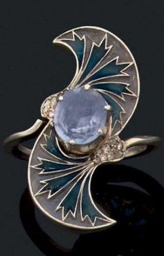 An Art Nouveau sapphire, plique-à-jour enamel and gold ring, circa 1900. I think dangerous as a ring to yourself or someone else.  On the other hand (Pun) it is beautiful. WFH.