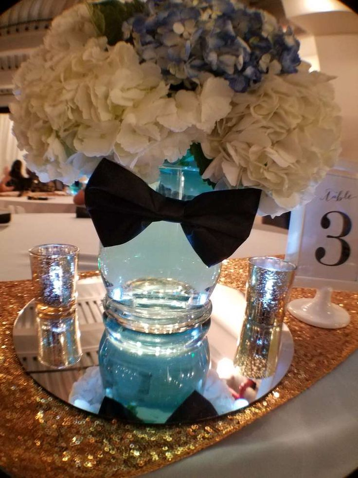 Pretty centerpiece at a mustache & bow tie baby shower party! See more party planning ideas at CatchMyParty.com!