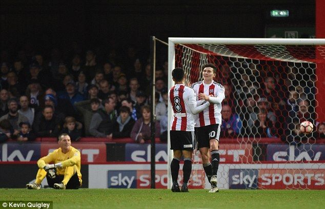 Tom Field celebrates his goal for Brentford as they thrashed Eastleigh