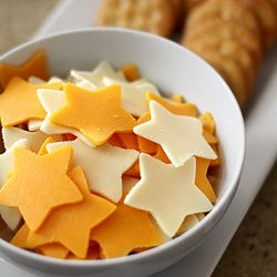 Use mozzarella sticks.Saturn's Rings = Lifesavers, Shooting Stars = Star shaped cheese (sliced cheese cup with cookie cutters), Asteroids = Popcorn, Crescent Moons = Apple Wedges