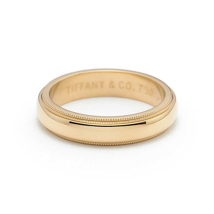 Tiffany & Co. -  Aliança de casamento Milgrain em ouro 18k, largura de 4 mm.