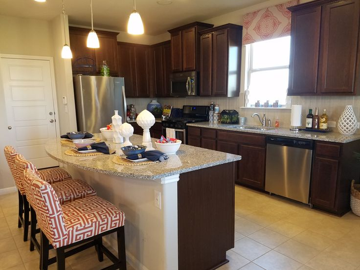 Gourmet style kitchen in the Meadows at Shadow Creek addition. Completewith granite counter-tops, stainless steel appliances and more.