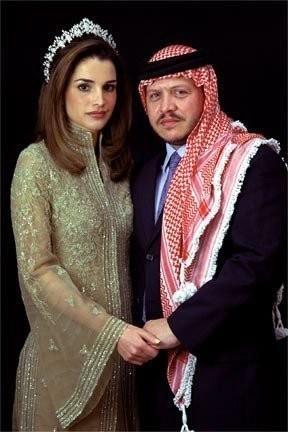 King of Jordan Abdullah II poses with his wife, Queen Rania on...