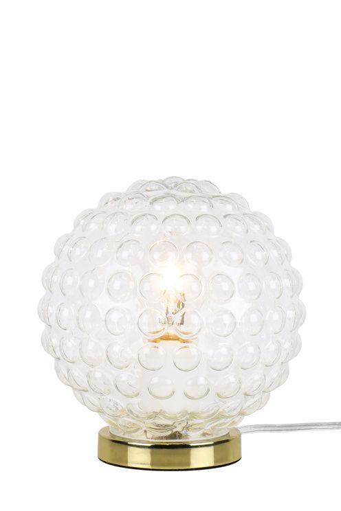 """Bordlampa """"Spring"""" är gjord i klart bubbligt 20-tals glas som ger en spännande ljusspridning. Fot i metall och transparent sladd med brytare. Höjd 20 cm. Diameter 17 cm. Lamphållare E27. Max 40W. Ljuskälla ingår ej. <br><br>"""