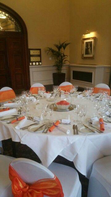 Orange fish bowl gerbera wedding crown hotel