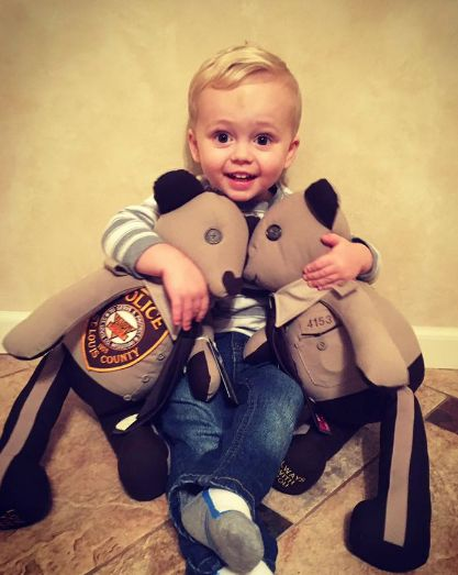 ST. LOUIS COUNTY, Mo. – St. Louis County Police Officer Blake Snyder, 33, was shot and killed in the line of duty Oct. 6. His widow, Elizabeth Snyder, posted a heart-warming picture on Instagram showing their son, 2-year old Malachi, hugging stuffed teddy bears made with his father's uniform.   http://www.lawenforcementtoday.com/priceless-bears/