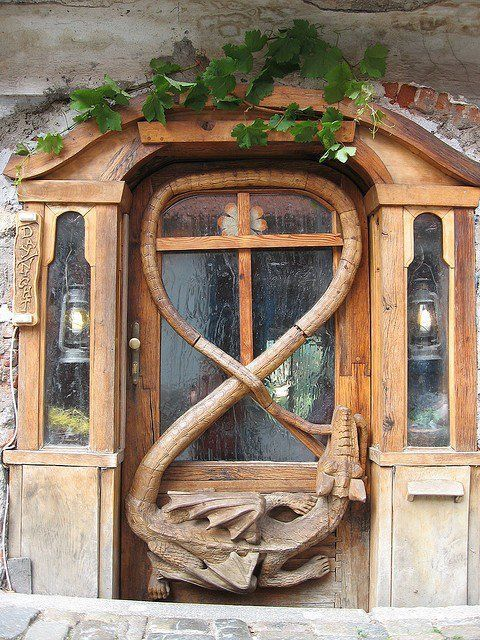 Visit this ornately carved wooden door with Medieval #dragon in a travel hostel called Krumlov House in The Czech Republic. http://www.krumlovhostel.com/