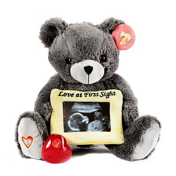 A recordable pregnancy keepsake, this teddy bear keeps the sound of your baby's ultrasound heartbeat safe and sound. 13 inches, fluffy fabric and poly fiber fill.