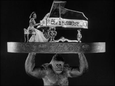"""Ray Harryhausen and his split screen process in Mighty Joe Young ( 1949 ) Actress Terry Moore is above playing """" BEAUTIFUL DREAMER """" on the piano."""