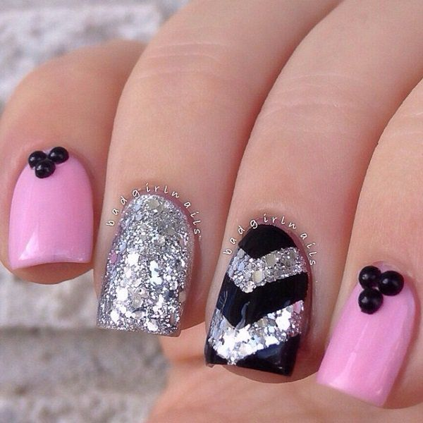 An adorable looking glitter nail art design in silver glitter, pink matte polish and black polish for the v-shape details finished with black beads on top.