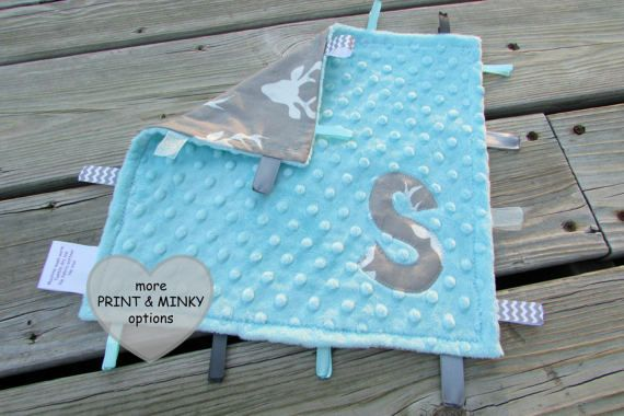 Woodland Lovie Sensory Blanket  by LovePitterPatter  Several different prints and minky colors available, as well as different sizes!  Perfect for a woodland/tribal nursery.    www.LovePitterPatter.etsy.com  #lovepitterpatter #woodlandbaby #sensorytoy #gray #aqua #navy #teepeetoy