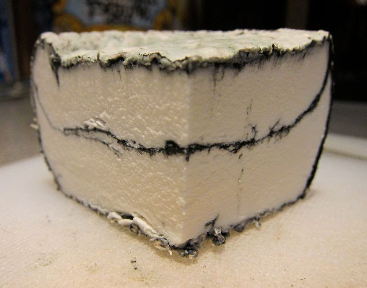 Using ash in cheesemaking---The history of ash in cheese making goes back hundreds of years to its use as a method to protect the surface of young cheese. As years passed, they later discovered that it also greatly improved the surface molds and how they grew on fresh cheeses for ripening.