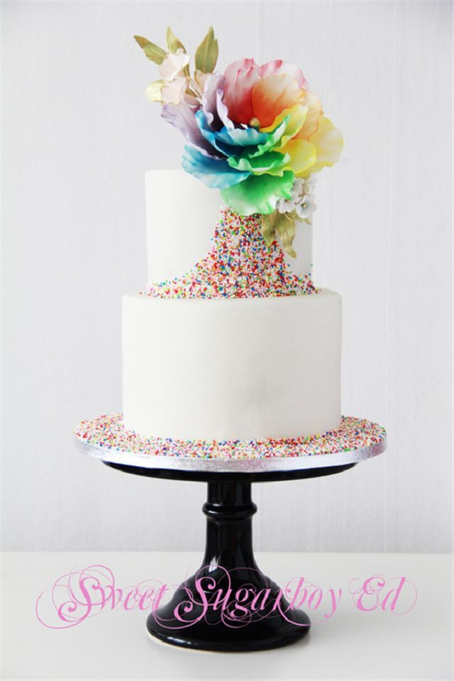 Pastel Wedding Cake,Two -Tier Cake, Rainbow Sprinkle Adorn the bottom and front with Rainbow Silk Flower, add a kill rainbow to your day !