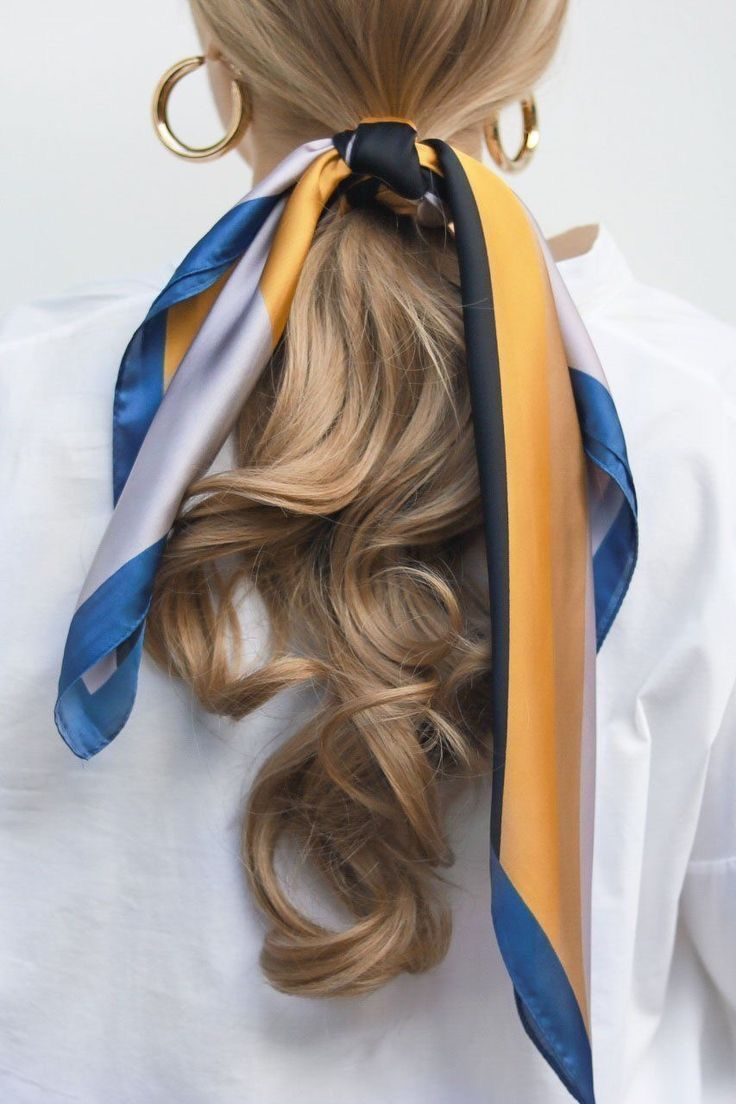 Tie a silk scarf round your ponytail for a fast and simple coiffure. Paired wit…