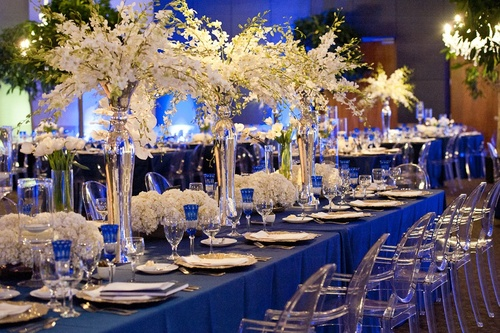 blue table linen with gold chargers, blue on the table is another concept to incorporate royal blue and white for banquet.