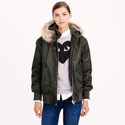 """Inspired by military-issued bomber jackets but much more glamorous (it even walked the runway in our fall/winter show) thanks to a sherpa-lined hood trimmed with faux fur. Designed with a slightly oversize silhouette so it's extra warm and cozy, it's made from a Japanese nylon twill with just the right amount of sheen. <ul><li>Oversize fit.</li><li>Body length: 27 3/8"""".</li><li>Sleeve length: 33 1/2"""".</li><li>Hits below hip.</li><li>Nylon.</li><li>Hooded.</li><li>Zip ..."""