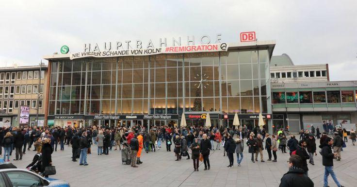 Identitäre Aktivisten besteigen Dach des Kölner Hauptbahnhofs und hissen Großbanner