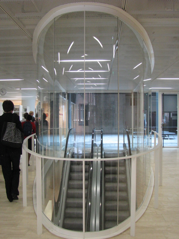 Kaisa Library, Helsinki University. Oval escalator well encased in laminated glass, echoing central oval motif.