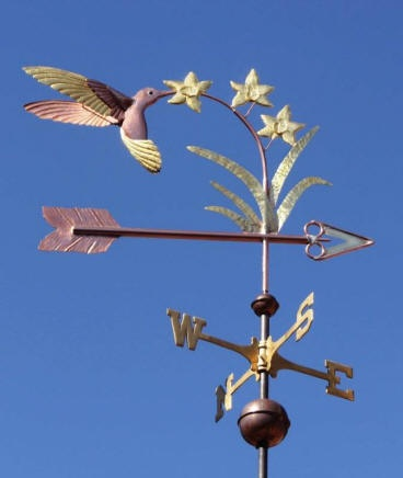 Hummingbird & Flowers Weather Vane by West Coast Weather Vanes.  The Hummingbird & Flowers weather vane featured has glass eyes that were custom made for this weather vane.  They give it a very life like appearance!