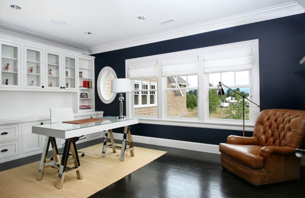 home office design, dark navy walls, white built-in cabinets, white trim, brown leather chair, modern saw-horse desk (Benjamin Moore, Hale Navy)