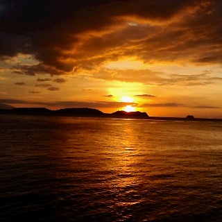 The golden sunset of Anilao, Batangas, Philippines - perfect scene to end a weekend dive.