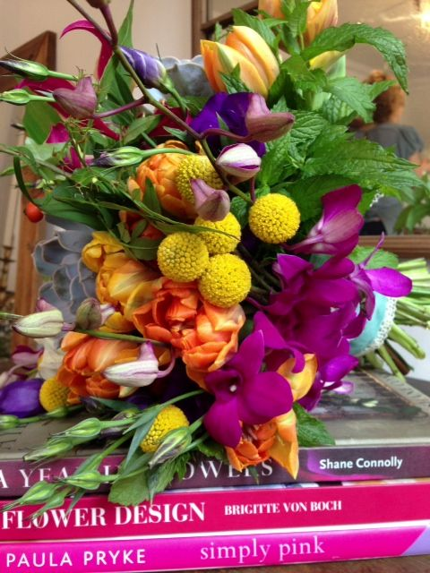 That colourful bridal bouquet up close and finished with a contrasting aqua velvet ribbon.