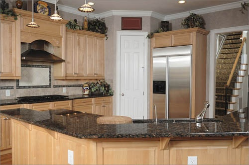 Maple cabinets w tan brown granite kitchens pinterest for Best color for kitchen cabinets for resale