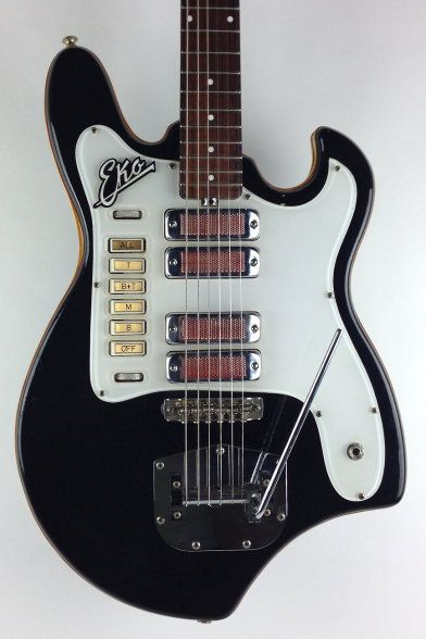 1960's Eko Electric Guitar in Black . Pushbuttons read, T (top pickup / neck position), B+T (bridge and neck pups), M (you guessed it--the middle two), B (bridge only) and OFF (which really means ALL ON, as in Control is now OFF). One roller for volume and one for tone, I forget which is which.