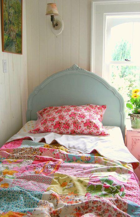 Summer bedroom, vintage twin bed, patchwork quilt.