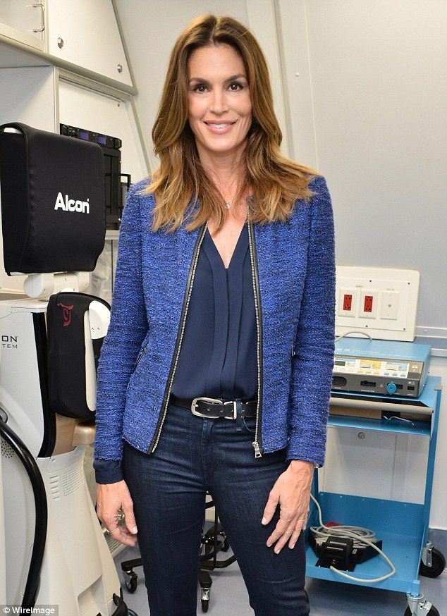 Brunette beauty: The 50-year-old looked chic in a min-blue wool jacket that she wore over a dark blue blouse and matching jeans