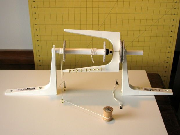 Spinning attachment for a treadle sewing cabinet. This ones for you Dee.