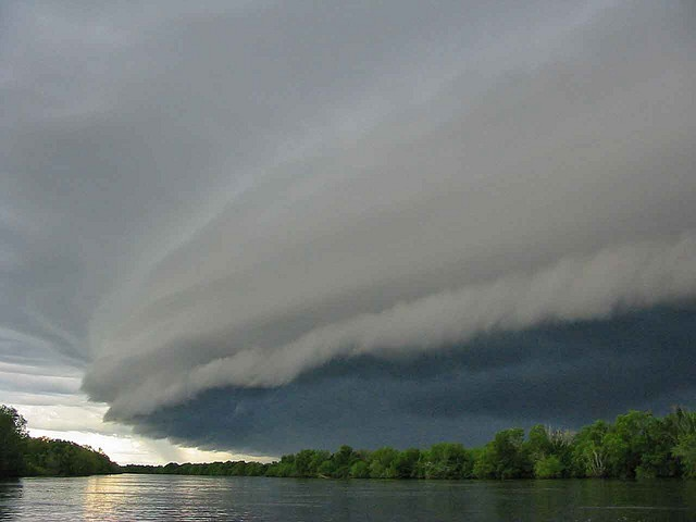 Storm shelf cloud front over the Adelaide River, Darwin in Northern Territory AU. Shot on April 15, 2006 by Chris Cattermole